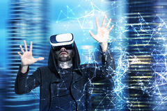 Man in VR glasses, office, network hologram Royalty Free Stock Photo