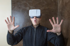 Man with VR glasses surprised gesture Royalty Free Stock Photos