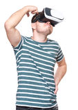 Man with VR glasses. Thoughtful man wearing virtual reality goggles watching movies or playing video games. Male looking in VR glasses, isolated on white Royalty Free Stock Image