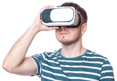 Man with VR glasses. Man wearing virtual reality goggles watching movies or playing video games - closeup. Male looking in VR glasses, isolated on white Royalty Free Stock Photos