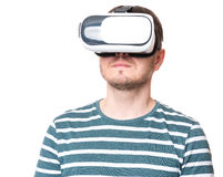 Man in VR glasses. Man wearing virtual reality goggles watching movies or playing video games - closeup. Male looking in VR glasses, isolated on white background Royalty Free Stock Images