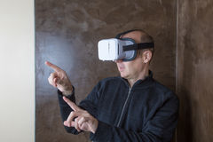 Man with VR goggles navigating menus Royalty Free Stock Photography