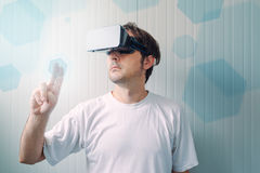 Man with VR goggles working in virtual reality environment Stock Photo