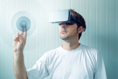 Man with VR goggles working in vurtual reality environment Royalty Free Stock Photos
