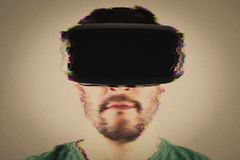 Man in VR-headset over glitch effect Royalty Free Stock Image