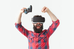 Man in VR headset screaming happily Stock Photography