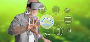 Man touching a cloud computing concept. Man with vr headset touching a cloud computing concept on a touch screen with his finger Royalty Free Stock Images