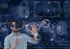Man in VR headset touching interface against purple interface background. Digital composite of Man in VR headset touching interface against purple interface Royalty Free Stock Photos