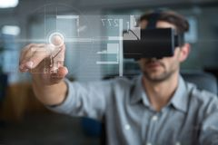 Man in VR headset touching interface with flare. Digital composite of Man in VR headset touching interface with flare Royalty Free Stock Photography