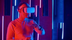 Man in VR headset touching virtual object.  stock video