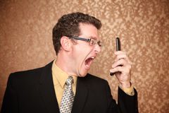 Man vs. Phone. Angry Business Man Shouting at His Phone Royalty Free Stock Photography