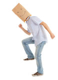 Man with vsmiling paper bag on head, full length Stock Photography