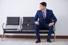The man wairing to boarding in airport lounge room. Man wairing to boarding in airport lounge room Stock Photos