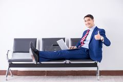 The man wairing to boarding in airport lounge room. Man wairing to boarding in airport lounge room Royalty Free Stock Photography