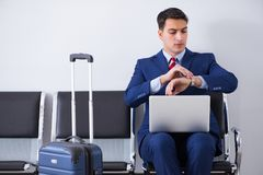The man wairing to boarding in airport lounge room. Man wairing to boarding in airport lounge room Royalty Free Stock Photo