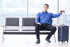 The man wairing to boarding in airport lounge room. Man wairing to boarding in airport lounge room Royalty Free Stock Image
