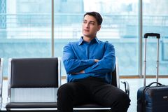 The man wairing to boarding in airport lounge room. Man wairing to boarding in airport lounge room Royalty Free Stock Photos