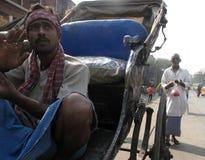 Man wait for passengers on their rickshaw in Kolkata Royalty Free Stock Photo