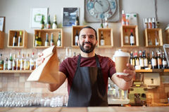 Man or waiter with coffee and paper bag at bar Royalty Free Stock Photography