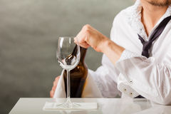 Man waiter pouring wine into glass. Male waiter or butler serving pouring wine into glass Royalty Free Stock Photography