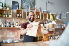Man or waiter serving customer at coffee shop Stock Photo