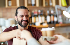 Man or waiter serving customer at coffee shop Stock Images