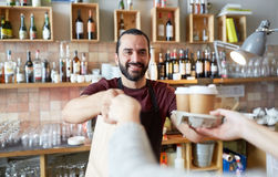 Man or waiter serving customer at coffee shop Royalty Free Stock Photo