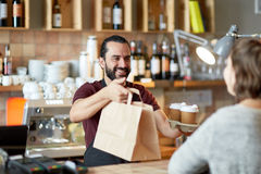 Man or waiter serving customer at coffee shop Stock Photos