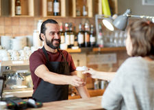 Man or waiter serving customer in coffee shop Stock Photography