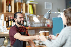 Man or waiter serving customer in coffee shop Stock Photos