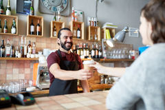 Man or waiter serving customer in coffee shop Royalty Free Stock Photography