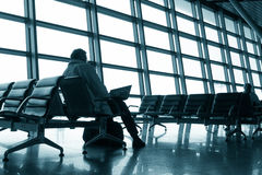 Man waiting in airport Stock Images
