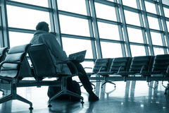 Man waiting in airport Royalty Free Stock Image