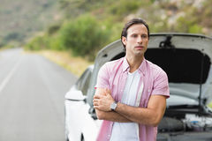 Man waiting assistance after a car breakdown Stock Photo