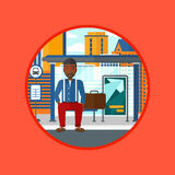 Man waiting for bus at the bus stop. Royalty Free Stock Photography