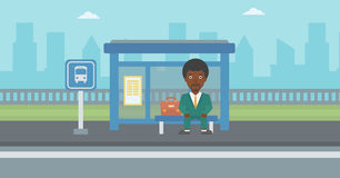 Man waiting for bus at the bus stop. Stock Image