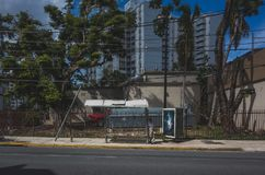 Man waiting for bus in San Juan royalty free stock images