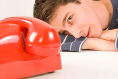 Man waiting for a call Stock Images