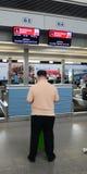 A man waiting for check in at Tan Son Nhat Airport, Vietnam Royalty Free Stock Photos