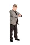 Man waiting for checks his watch. Elegant middle aged man waiting for checks his watch Stock Photos