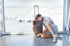 Man waiting for his flight in the international airport Stock Images