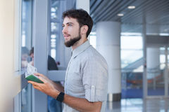 Man waiting for his flight in the international airport Stock Photos