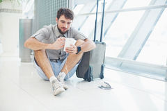 Man waiting for his flight in the international airport Royalty Free Stock Photography