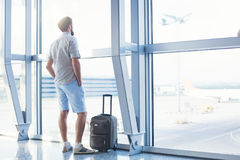 Man waiting for his flight in the international airport Royalty Free Stock Photo