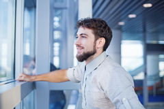 Man waiting for his flight in the international airport Royalty Free Stock Image