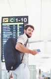 Man waiting for his flight in the international airport Royalty Free Stock Photos