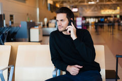 Man waiting for his flight Stock Photos