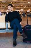 Man waiting for his flight Royalty Free Stock Images