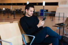 Man waiting for his flight Stock Images