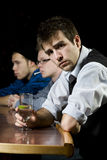 Man waiting with his friends at bar Royalty Free Stock Photography